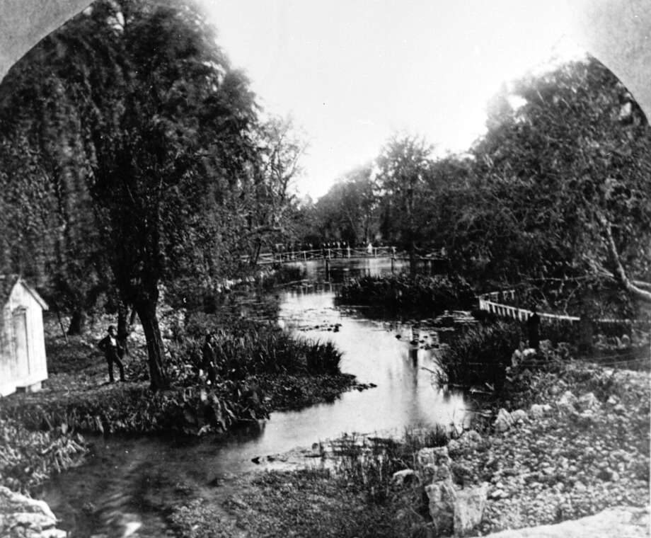 San Pedro Springs in 1869. Named by the Spanish in 1708, San Pedro Springs became the city of San Antonio's first park in 1852. J.J. Durler, whose house was located at the head of the springs, was responsible for building many of the park's early bridges and walkways. Photo: Ernst Raba /San Antonio Conservation Society / San Antonio Conservation Society