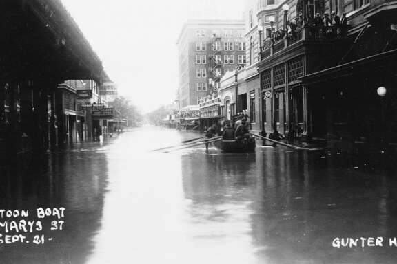Soldiers floated in a boat down St. Mary's Street in September 1921, during flooding, which was a major downtown problem in the early 20th century.