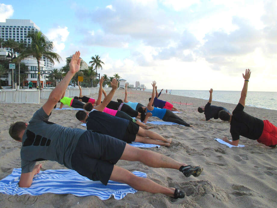 Fit-minded folks warm up for the W Fort Lauderdale's Beach Boot Camp circuit. Photo: Robin Soslow / For The Express-News
