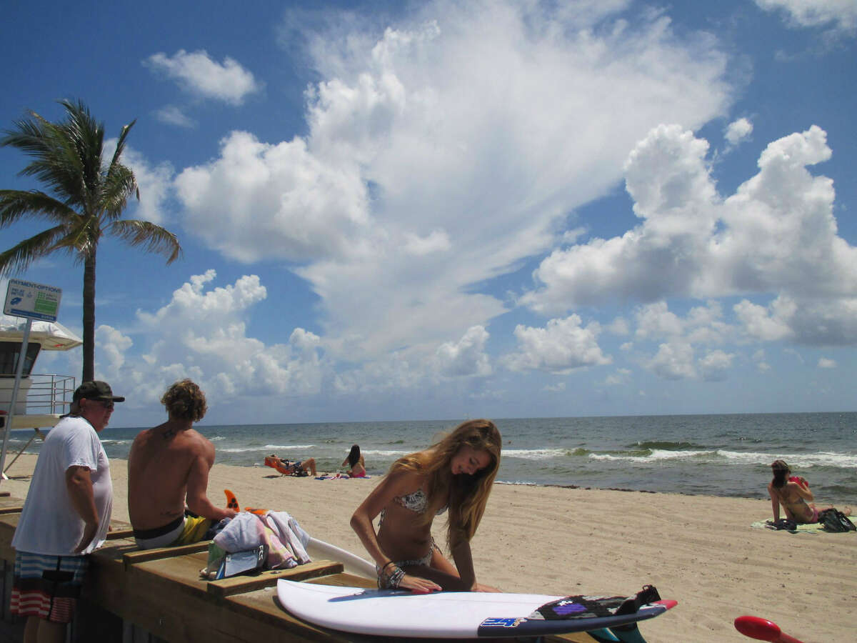 Surfing is one of many ways to exercise in the ocean in Fort Lauderdale.