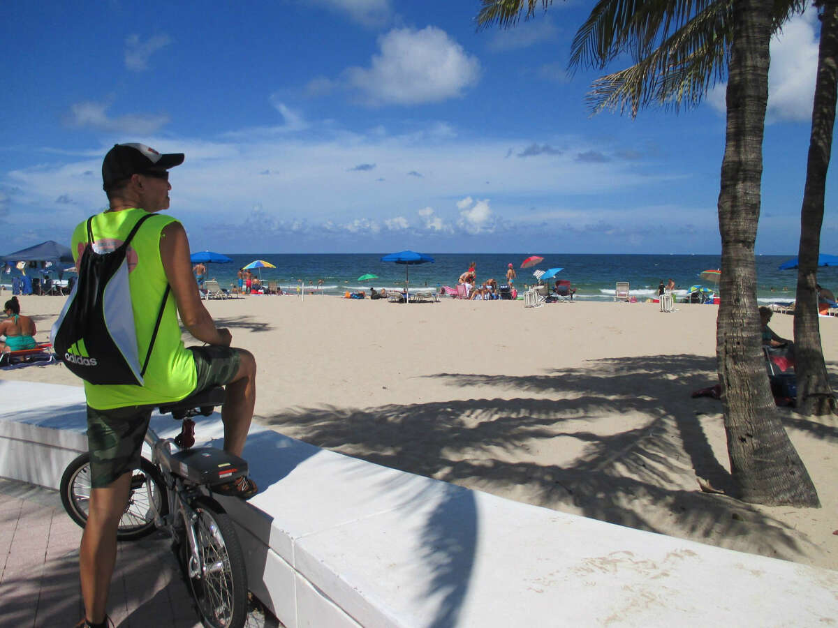 While bicycling along the promenade in Fort Lauderdale, visitors and locals can enjoy the ocean views.