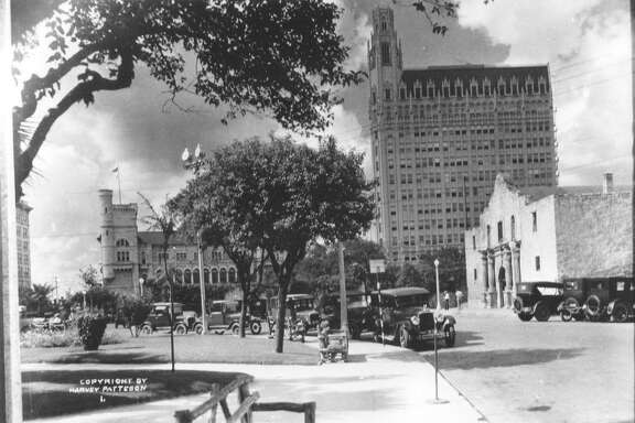 The Alamo and Alamo Plaza. Photo is labeled as being from 1920-1930, but it would then have to be late 1920s because of the Medical Arts (now the Emily Morgan Hotel) building in the background. The Federal building is to the left behind the trees. Photo by Harvey Patteson. Courtesy of the Harry Ransom Center