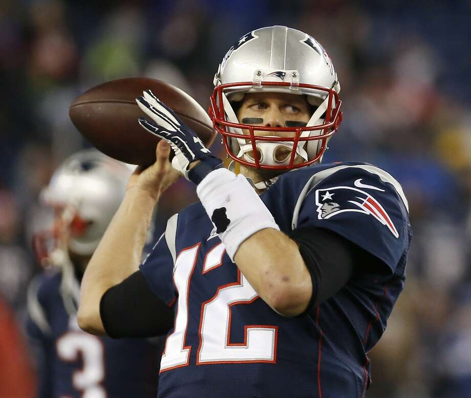 New England Patriots quarterback Tom Brady warms up before the NFL football AFC Championship game between the New England Patriots and Indianapolis Colts Sunday, Jan. 18, 2015, in Foxborough, Mass. (AP Photo/Elise Amendola) Photo: Elise Amendola, Associated Press