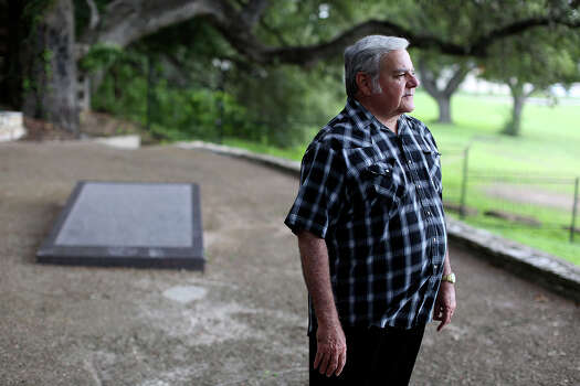 Albert Seguin Gonzales, of Texas City, stands at the burial site of his fourth great grandfather, Alamo defender Juan Seguin, in Seguin on Oct. 3, 2013. Photo: Lisa Krantz /San Antonio Express-News / San Antonio Express-News