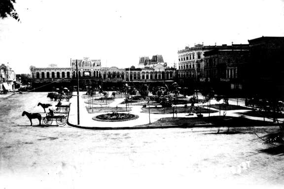 Looking north on Main Plaza, 1893. Left to right: L. Wolfson's dry goods store, White Elephant saloon and Charles J. Langholtz's saddlery. The twin mansard roofs visible in the center belong to the Old Court House (1882-1892) on Soledad Street.