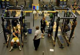 Cal football players work out in their new state-of-the-art weight room at Memorial Stadium in 2013 in Berkeley. Sharp divisions among the UC regents likely reflect the public's views on academic standards for athletes.