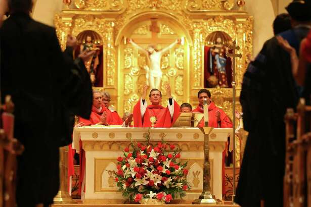 San Antonio Archbishop Gustavo Garcia-Siller (center) leads the 62nd annual Red Mass at San Fernando Cathedral. The Red Mass is a special ceremony held for members of the legal industry.