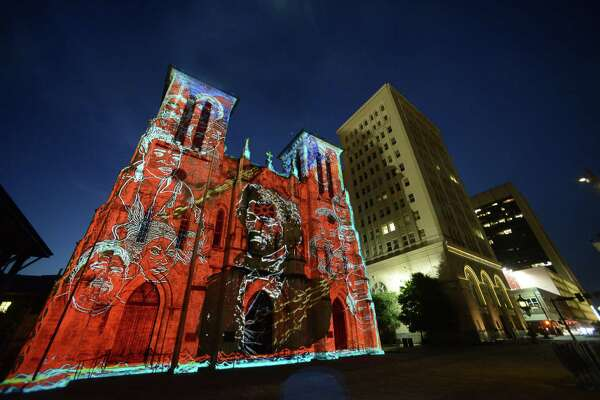 """An image of African American social reformer Frederick Douglass is projected onto San Fernando Cathedral during a showing of """"San Antonio: The Saga"""" by renowned French artist Xavier de Richemont, on June 11, 2014. The film visually narrated the historical discovery, settlement and development of San Antonio."""