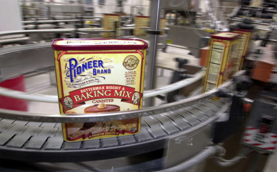 Boxes of Buttermilk Biscuit & Baking Mix move along a conveyor belt inside the Pioneer Flour mill. Photo: Edward A. Ornelas / San Antonio Express-News / SAN ANTONIO EXPRESS-NEWS