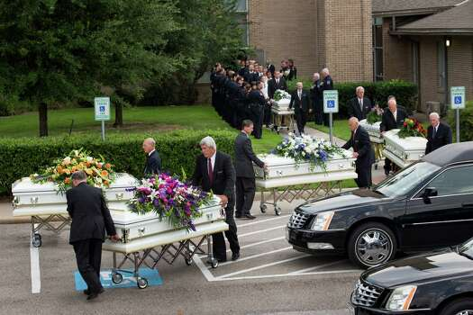 Caskets carrying the six members of the Stay family are carried from at The Church of Jesus Christ of Latter-Day Saints following funeral services Wednesday, July 16, 2014, in Houston. Ronald Lee Haskell is accused of killing the family members at their Spring home. Photo: Brett Coomer, Houston Chronicle / © 2014 Houston Chronicle
