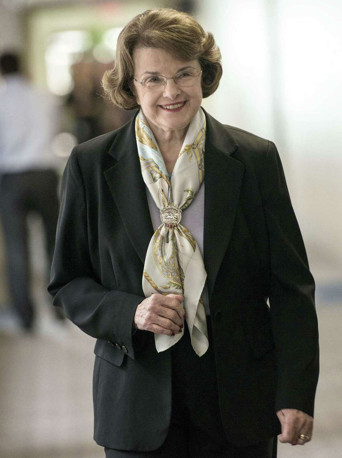 (FILES) This April 3, 2014 file photo shows Senator Dianne Feinstein D-CA as she walks to a closed meeting of the Senate Intelligence Committee on Capitol Hill in Washington, DC. The lawmaker behind the explosive US Senate report on enhanced interrogation techniques presented several torture prevention proposals on January 5, 2015 to President Barack Obama including a ban on the CIA holding detainees. Senator Dianne Feinstein said she would introduce legislation early in the congressional session, which begins January 6, 2014, that would close