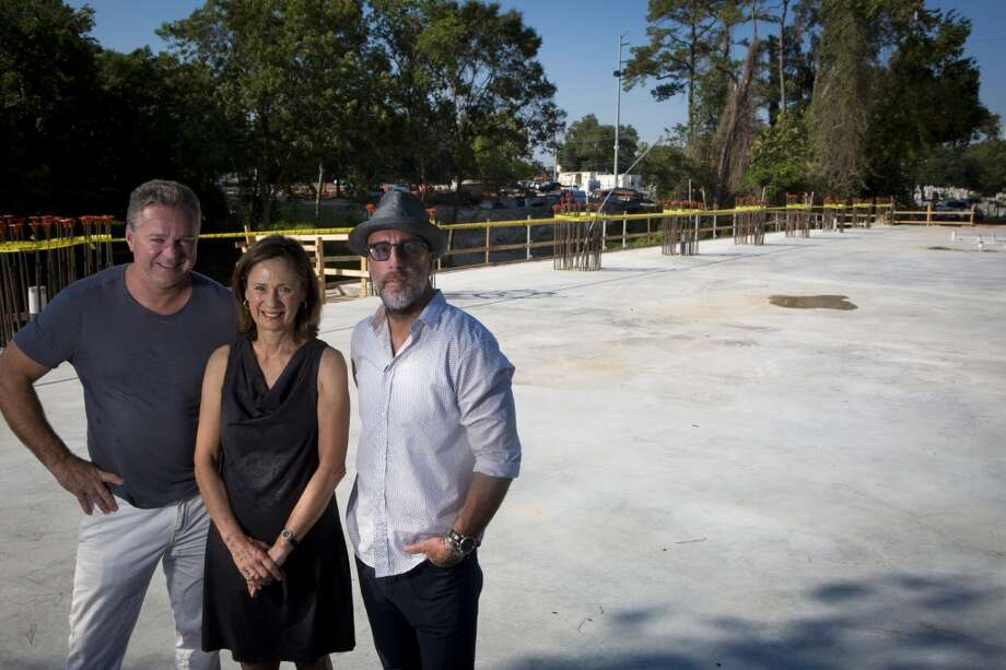 Charles Clark, left, Sis Johnson and Grant Cooper stand on what will be the The Dunlavy, a cafe for the Buffalo Bayou Park users and a special events space. The project will be completed during the summer of 2015. Wednesday, Aug. 13, 2014, in Houston. ( Marie D. De Jesus / Houston Chronicle ) Photo: Marie D. De Jesus, Houston Chronicle
