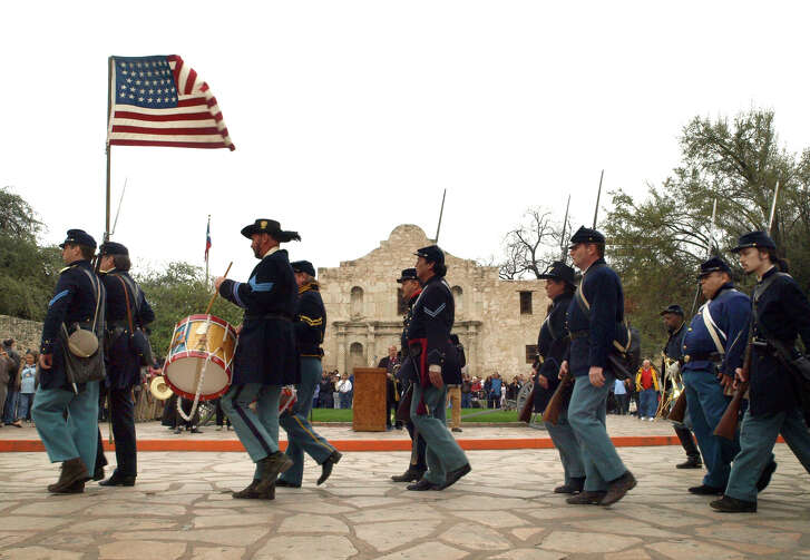 History re-enactors portraying Federal troops leave the Alamo following the surrender of the fort to the state of Texas by General David Twiggs in February 1861.