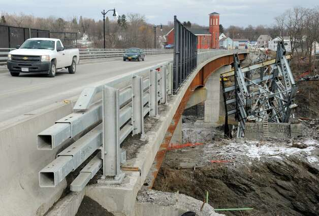 The old route 40 bridge over the Hoosick River was demolished on Friday Jan. 23, 2015 in Schaghticoke, N.Y. The old bridge built in 1942 was replaced by the new bridge which opened on Nov. 14, 2014.(Michael P. Farrell/Times Union) Photo: Michael P. Farrell