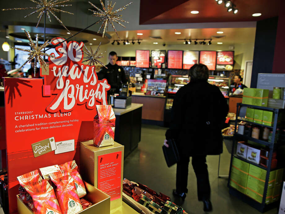 Holiday sales at Starbucks stores are a big reason for the profit increase. It said 1 in 7 people received a Starbucks gift card. Photo: Ted S. Warren / Associated Press / AP
