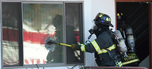 The Albany Fire Department knocks down a fire in one of the units of the Freedom Apartments at the University at Albany Friday Jan. 23, 2015 in Albany, N.Y.       (Skip Dickstein/Times Union) Photo: SKIP DICKSTEIN / 00030333A