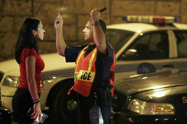 MIAMI - DECEMBER 15:  Officer Kevin Millan from the City of Miami Beach police department conducts a field sobriety test at a DUI traffic checkpoint December 15, 2006 in Miami, Florida. According to police, the woman failed a breathalyzer test by blowing into the device and receiving two readings one at .190 the other .183, which is twice the legal limit in Florida. The city of Miami, with the help of other police departments, will be conducting saturation patrols and setting up checkpoints during the holiday period looking to apprehend drivers for impaired driving and other traffic violations.