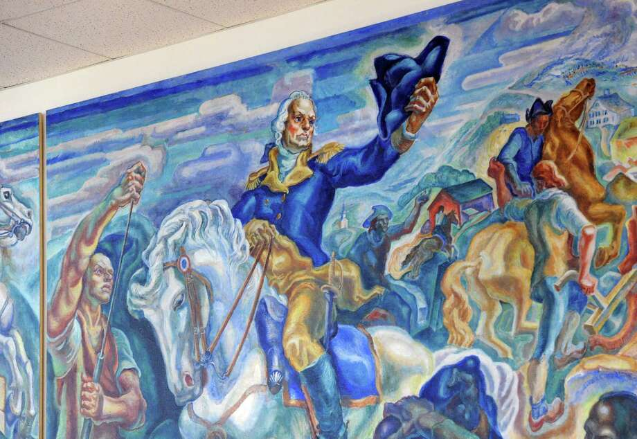 "The nine-by-twenty-two foot oil on canvass depression-era work of artist James Henry Daugherty titled ""The Life and Times of General Israel Putnam of Connecticut,"" hangs on the wall in Greenwich Library, Conn., Firday, Jan. 23, 2015. The mural depicts the heroic exploits of General Putnam, including his escape from the British down ""Put's Hill"" during the American Revolutionary War as well as Putnam leading his troops during the Battle of Bunker Hill that is seen here in the center panel. Photo: Bob Luckey / Greenwich Time"