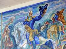 "The nine-by-twenty-two foot oil on canvass depression-era work of artist James Henry Daugherty titled ""The Life and Times of General Israel Putnam of Connecticut,"" hangs on the wall in Greenwich Library, Conn., Firday, Jan. 23, 2015. The mural depicts the heroic exploits of General Putnam, including his escape from the British down ""Put's Hill"" during the American Revolutionary War as well as Putnam leading his troops during the Battle of Bunker Hill that is seen here in the center panel."