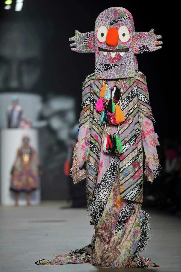 A model wears a creation for designer Bas Kosters' Fall/Winter 2015 collection during the Mercedes-Benz Fashion Week in Amsterdam, Netherlands, Friday, Jan. 23, 2015. Photo: Peter Dejong, Associated Press / AP