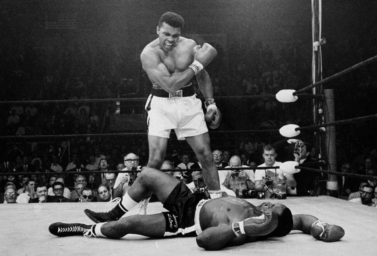 Muhammad Ali stands over Sonny Liston in 1965.