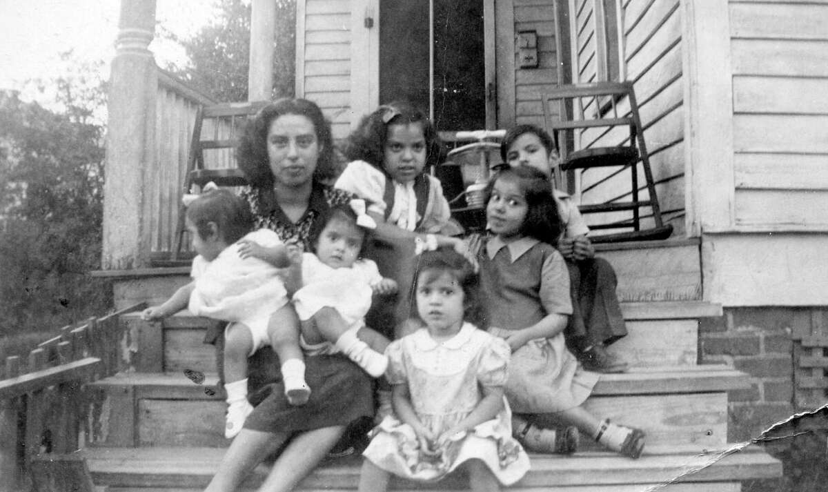 Petra Guillen raised 13 children in her East End home. Here, the family in front of their home at 31 Saint Charles Street in the late 1940's. (Photo courtesy of Guillen family)