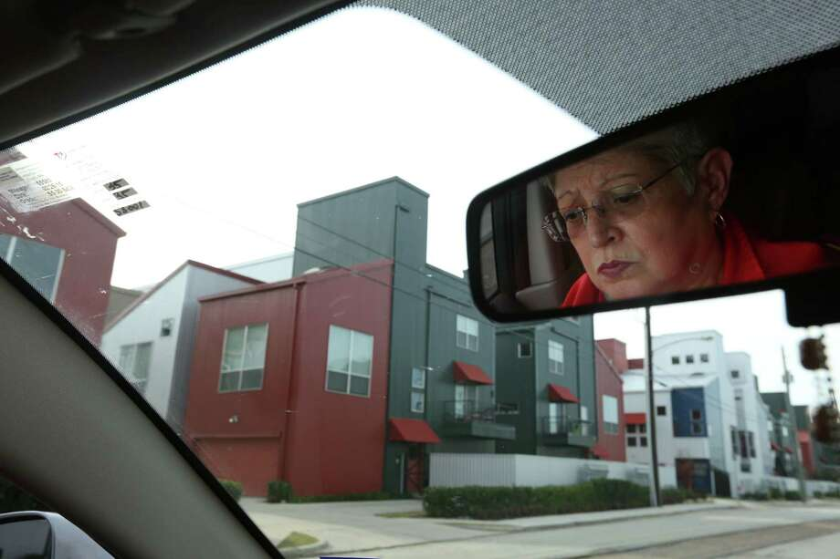 Diane Garay, daughter of Petra Guillen, drives through Commerce Street on her way to pick up her grandchildren, who attend school at Our Lady of Guadalupe Church. The family represents the traditional residents of the East End -- Mexican-American families who staked claims in the small bungalows and cottages and are now seeing rapid change. Photo: Mayra Beltran, Houston Chronicle / © 2015 Houston Chronicle