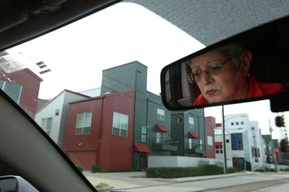 Diane Garay, daughter of Pretra Guillen, drives through Commerce St. on her way to pick up her grandchildren who attend school at Our Lady of Guadalupe Church on Thursday, Jan. 15, 2015, in Houston. The Guillen Family represent the traditional residents of the East End- Mexican-American families who staked claims in the small bungalows and cottages. Now, that community is feeling squeezed out by developers and boxy warehouse-like townhouses sprouting up all over the neighborhood.