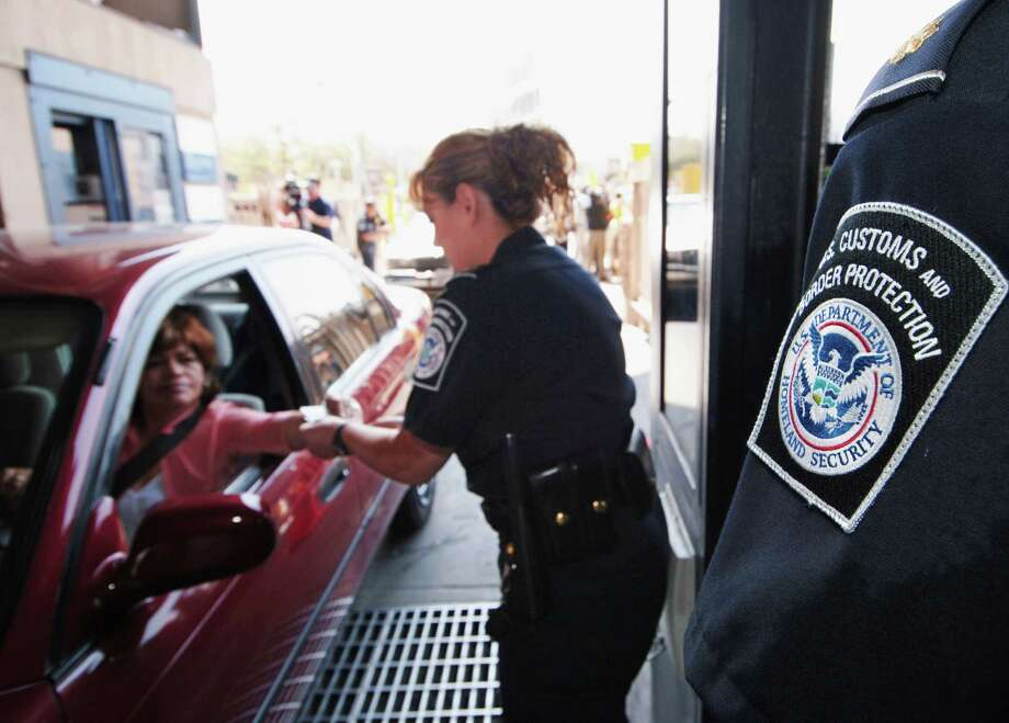 U.S. Customs and Border Protection inspectors have seen a recent uptick in seizures of drugs hidden under the cars of prescreened, unsuspecting drivers. Photo: Denis Poroy, STR / AP