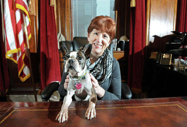 Mayor Kathy Sheehan and her Boston terrier, Ozzie, on Wednesday, Dec. 24, 2014, in the Mayor's office in Albany, N.Y. (Cindy Schultz / Times Union) Photo: Cindy Schultz / 518Life / 00029976A