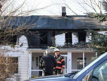 Greenwich firefighters respond to a 5:45 a.m. blaze at 178 Weaver Street in Greenwich after a neighbor was awakened early Friday by the bright light and 30 to 40 foot high flames. No one was injured, but the house sustained heavy damage.