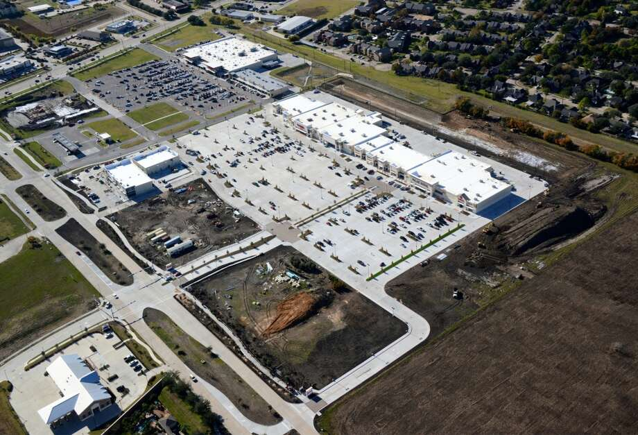AFTER: The Center at Pearland Parkway, a 165,000-square-foot power developed by Stream Realty Partners at FM 518 and Pearland Parkway, is now open.  Tenants are: T.J. Maxx, Ross Dress for Less, Petco, Palais Royal, Five Below, Rack Room, Rue 21, Salons by JC, Payless, Americaís Best Contacts & Eyewear, MOD Pizza, Mattress Firm, Massage Envy, European Wax Center, Paris Nails & Spa, Sprint and Menchies Yogurt Photo: Stream Realty Partners