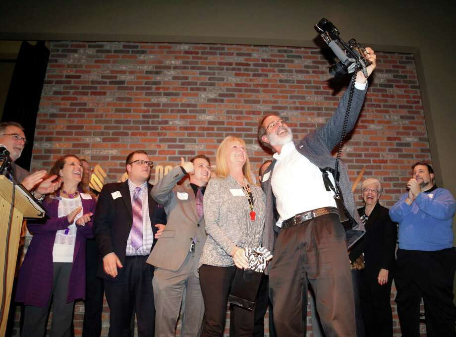 David Postma is trying to take a selfie with Jeannie Bollinger, President of the Houston West Chamber of Commerce and the other volunteers for 2014. Photo: Houston West Chamber