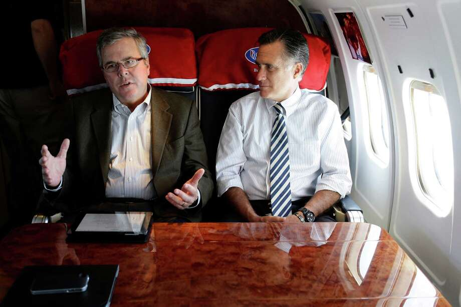FILE - In this Oct. 31, 2012 file photo, then-Republican presidential candidate, former Massachusetts Gov. Mitt Romney talks with former Florida Gov. Jeb Bush as they fly on his campaign plane to Miami Fla. Outlining his possible rationale for a third presidential bid, Mitt Romney said Wednesday night that political leaders in both parties are failing to address the nation's most pressing problems _ climate change, poverty and education reform, among them _ as he acknowledged lessons learned from his failed 2012 presidential campaign. It came hours before he was scheduled to meet privately with Bush, whose aggressive steps toward a White House bid of his own helped force Romney's hand. Should they both run, they would compete for much of same establishment support.  (AP Photo/Charles Dharapak, File) Photo: Charles Dharapak / Associated Press / AP