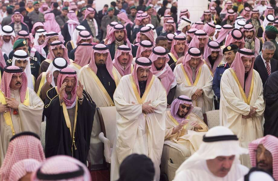 The new Saudi King Salman, center, prays at the funeral of his half-brother, King Abdullah in Riyadh. Photo: - / AFP / Getty Images / AFP