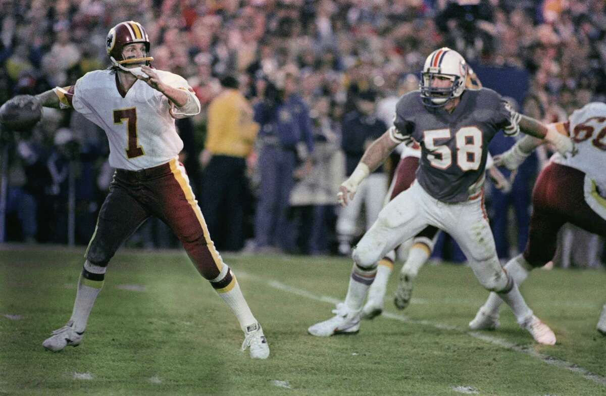 Joe Theismann, Super Bowl XVII The quarterback's biggest play came as a defender. With Miami up 17-13, Theismann knocked an interception out of defensive lineman Kim Bokamper's (58) hands just shy of the end zone to prevent a sure touchdown. Washington rallied to win 27-17.