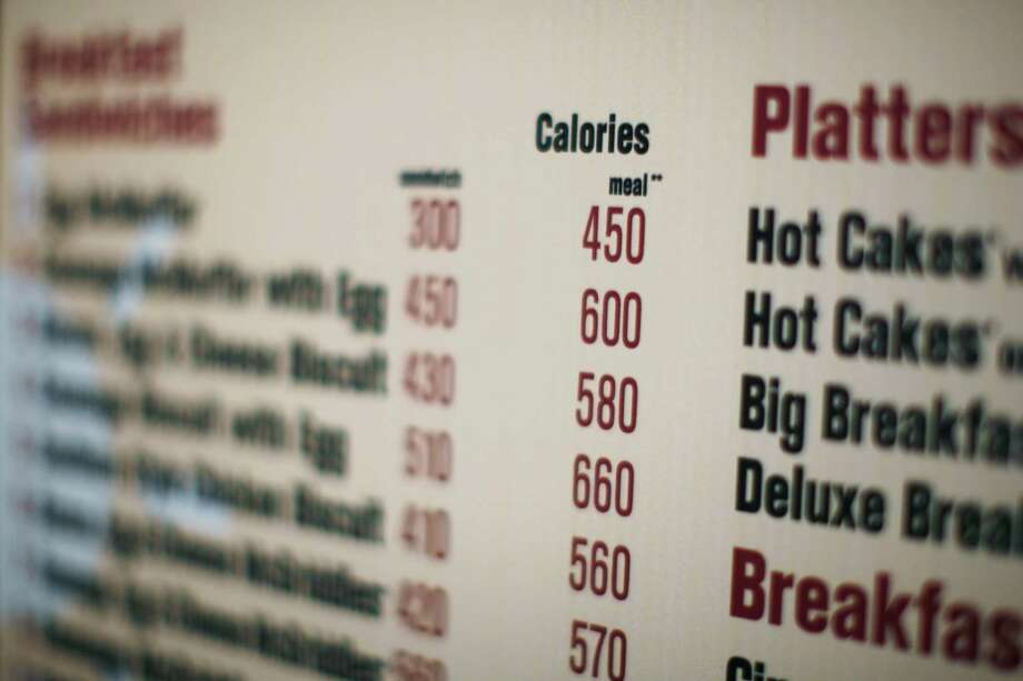 A new paper in Public Health Nutrition warns that focusing on calories instead of encouraging selection of high-nutrition foods can lead to consumption of more fatty and sweet foods, not less. Photo: Ed Ou, STF / AP