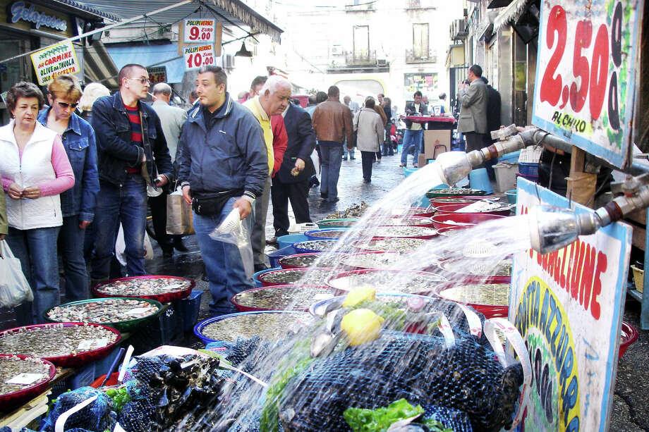 Explore a colorful open-air market in Naples for great people-watching, and become part of the vivid tableau. Photo: Rick Steves