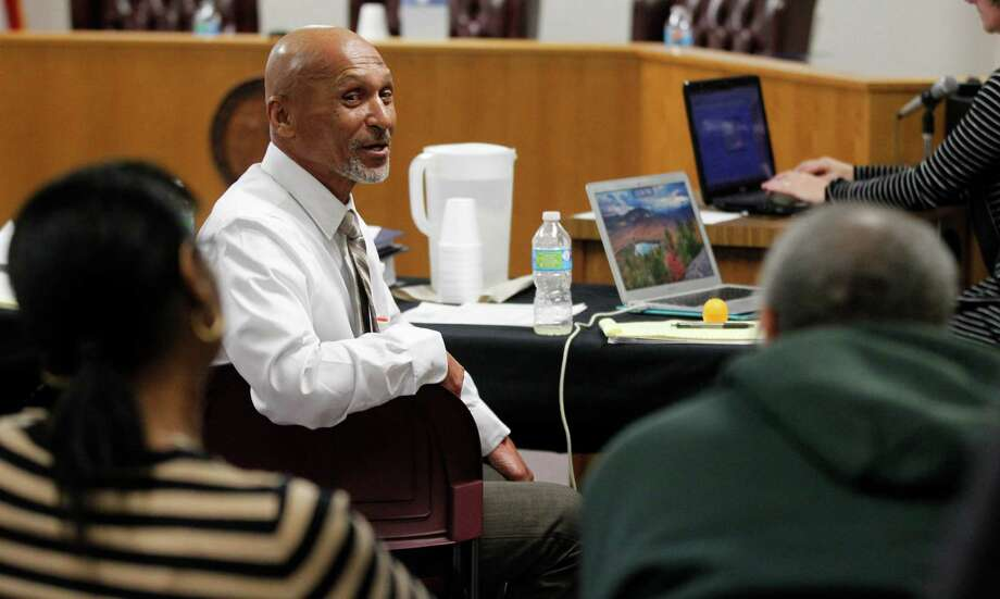 Joseph Sledge, center, talks with his sister Barbara and brother Oscar during a break as a three-judge panel takes up his claim of innocence in Whiteville, N.C., on Friday, Jan. 23, 2015. The panel planned to consider whether Sledge was wrongfully convicted nearly four decades ago of killing a mother and daughter in North Carolina. (AP Photo/The News & Observer, Ethan Hyman) Photo: Ethan Hyman, MBO / The News & Observer