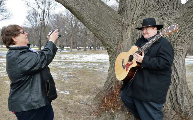 """Wynantskill photographer E. Marie DeShaw, left, takes pictures of Bill Winchester of East Greenbush for his new CD """"Moonlight Confessions"""" in Washington Park Friday Jan. 23, 2015, in Albany, NY.  (John Carl D'Annibale / Times Union) Photo: John Carl D'Annibale"""