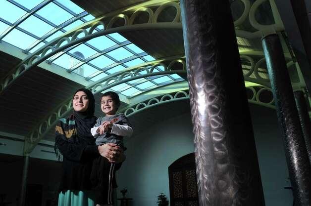 Uzma Popal holds her son, Yusuf Popal, 3, inside the Al-Hidaya Center, Islamic Community Center of Troy & Latham on Thursday, Jan. 15, 2015, in Latham, N.Y.  Uzma is the current coordinator of the MSKP, which has been in existence since 2003.    (Paul Buckowski / Times Union) Photo: Paul Buckowski / 00030209A