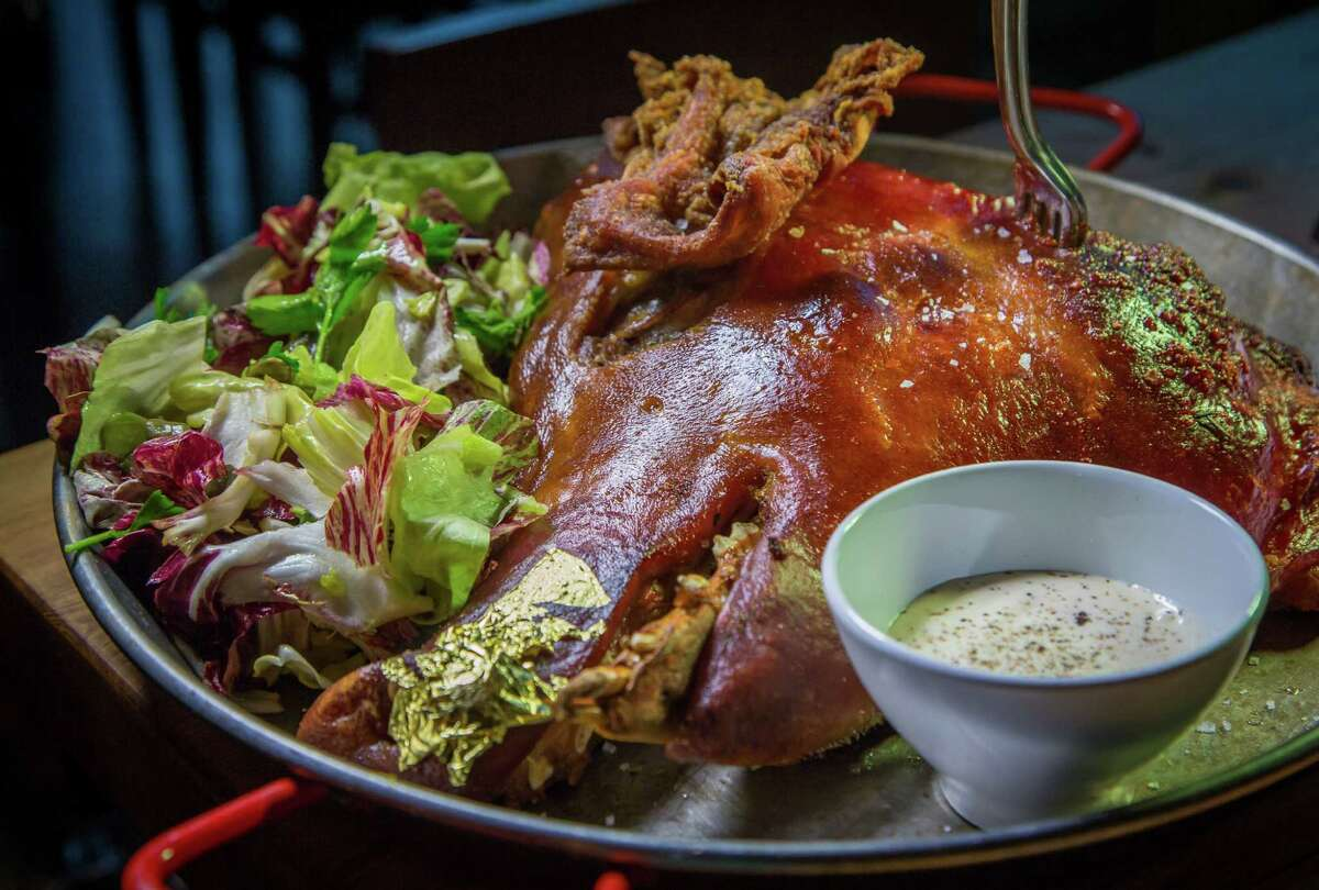 Wood oven roasted pig's head at Cockscomb in San Francisco.