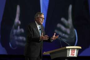 Former Florida Gov. Jeb Bush delivers the keynote speech at the National Automobile Dealers Association convention at Moscone Center in S.F.