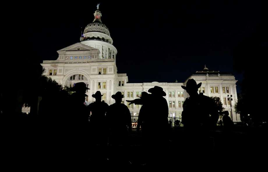 Texas state troopers hold a meeting outside the Texas Capitol prior to the inauguration for Gov.-elect  Greg Abbott, Tuesday, Jan. 20, 2015, in Austin, Texas. (AP Photo/Eric Gay) Photo: Eric Gay, STF / AP