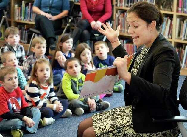 Congresswoman Elise Stefanik reads to Kindergarteners as part of her tour of Gordon Creek Elementary School Friday Jan. 23, 2015, in Ballston Spa, NY.   (John Carl D'Annibale / Times Union) Photo: John Carl D'Annibale / 00030322A