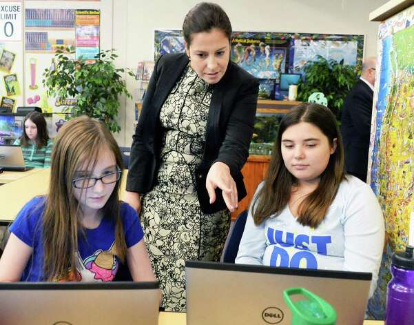 Congresswoman Elise Stefanik, a member of the House Committee on Education and the Workforce, looks over the work of 5th graders Avery Scatena, left, and Alison Lee during her tour of Gordon Creek Elementary School Friday Jan. 23, 2015, in Ballston Spa, NY.   (John Carl D'Annibale / Times Union) Photo: John Carl D'Annibale / 00030322A