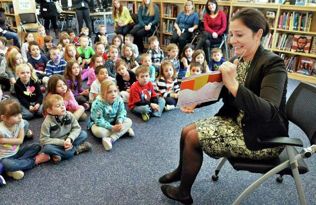 """Congresswoman Elise Stefanik gives an animated reading of Ezra Jack Keats' """"A Snowy Day"""" to Kindergarteners as part of her tour of Gordon Creek Elementary School Friday Jan. 23, 2015, in Ballston Spa, NY.   (John Carl D'Annibale / Times Union) Photo: John Carl D'Annibale / 00030322A"""