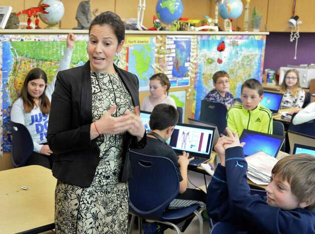 Congresswoman Elise Stefanik, a member of the House Committee on Education and the Workforce, spaaks with 5th graders during her tour of Gordon Creek Elementary School Friday Jan. 23, 2015, in Ballston Spa, NY.   (John Carl D'Annibale / Times Union) Photo: John Carl D'Annibale / 00030322A