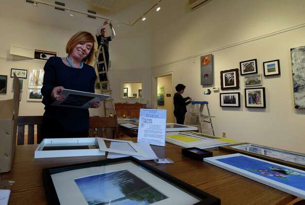 Maureen Sager, executive director of the Gallery, left works on framing pieces for the Spring Street Gallery show Wednesday afternoon Jan. 21, 2015 in Saratoga Springs, N.Y.      (Skip Dickstein/Times Union) Photo: SKIP DICKSTEIN / 00030296A