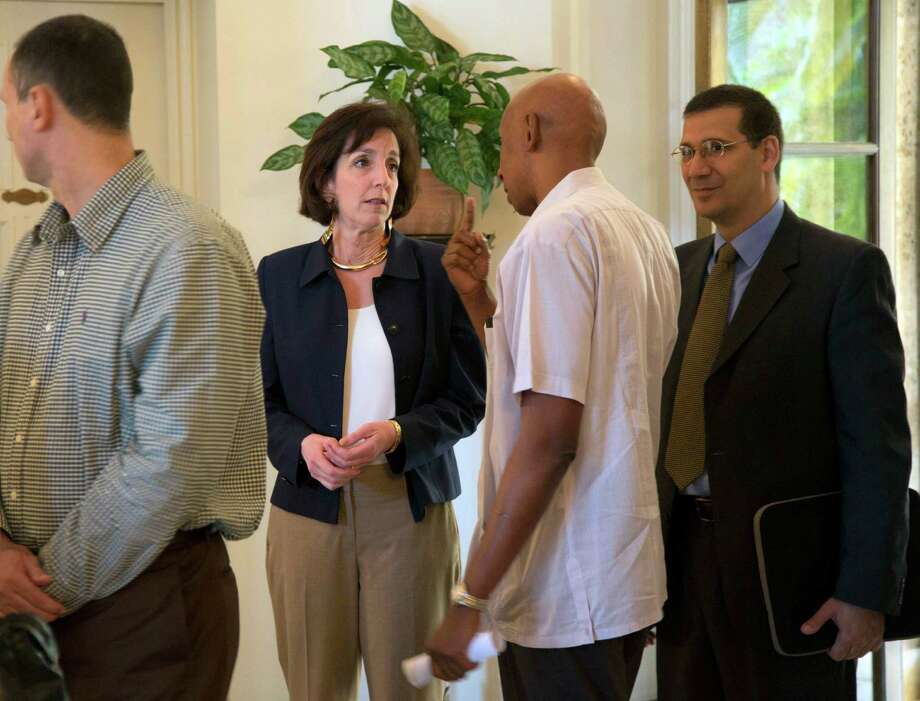 U.S. Assistant Secretary of State for Western Hemisphere Affairs Roberta Jacobson talks with Cuban dissident Guillermo Farinas at the the U.S. Interests Section in Havana. , Cuba, Friday, Jan. 23, 2015. (AP Photo/Ramon Espinosa, Pool) Photo: Ramon Espinosa /Associated Press / AP